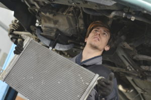 Car mechanic is Changing new radiator